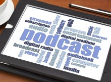 podcast word cloud on a digital tablet with a cup of coffee - internet radio concept