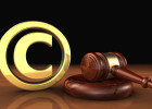 Copyright intellectual property and digital copyright laws conceptual illustration with symbol and icon and a gavel on black background.